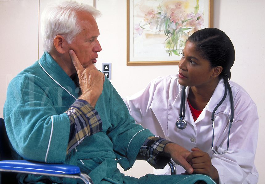 African-american female doctor with male senior patient.