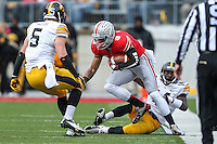 Ohio State Buckeyes wide receiver Devin Smith (9) is brought down during Saturday's game in Columbus, Ohio on Saturday, Oct. 19, 2013. (Jabin Botsford / The Columbus Dispatch)