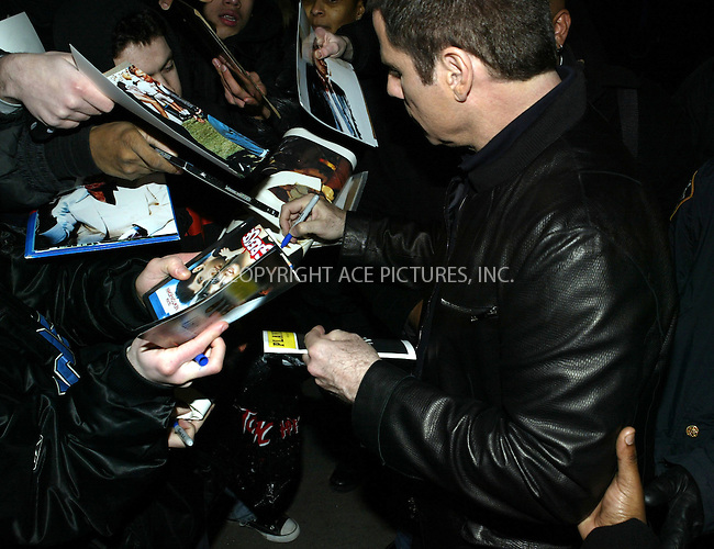 WWW.ACEPIXS.COM . . . . .  ....NEW YORK, FEBRUARY 23, 2005....John Travolta arrives at MTV's TRL.....Please byline: Ian Wingfield - ACE PICTURES..... *** ***..Ace Pictures, Inc:  ..Philip Vaughan (646) 769-0430..e-mail: info@acepixs.com..web: http://www.acepixs.com