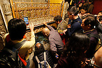 Christian worshippers gather around the Grotto at the Church of the Nativity, believed the birthplace of Jesus Christ, in the West Bank city of Bethlehem, on December 20, 2015. Photo by Wisam Hashlamoun
