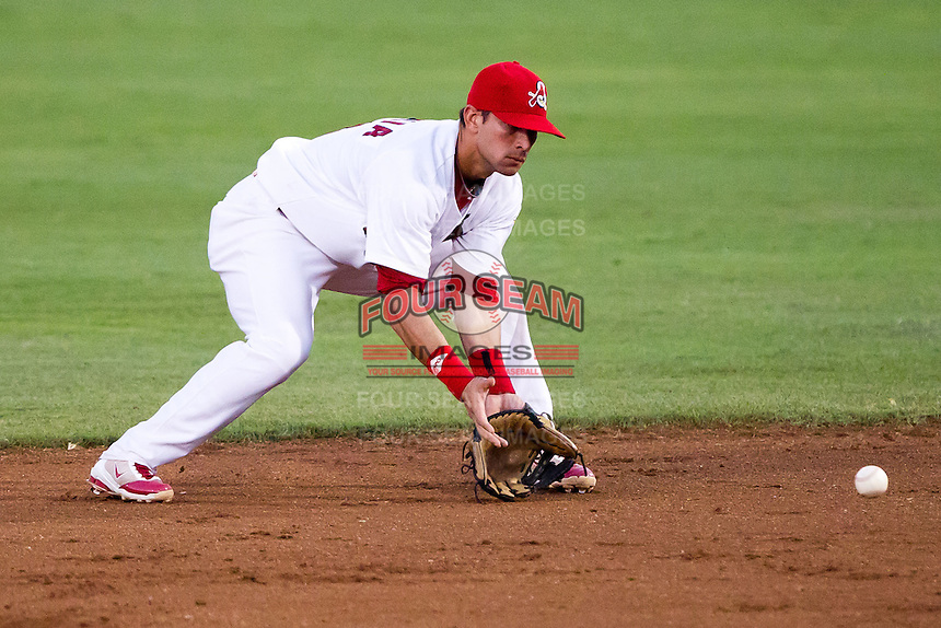 Jose Garcia (3) of the Springfield Cardinals tries to make a play on a ground ball during a game against the Tulsa Drillers at Hammons Field on July 20, 2011 in Springfield, Missouri. Springfield defeated Tulsa 12-1. (David Welker / Four Seam Images)