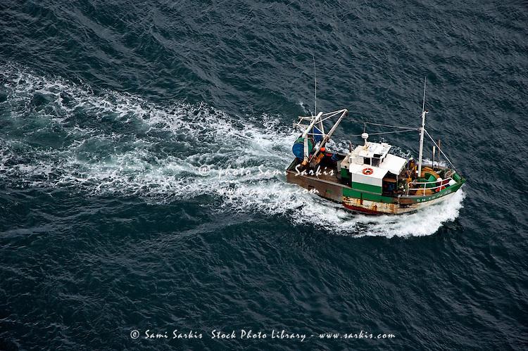 Fishing boat at sea, Brittany, France.
