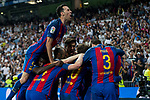 Leo Messi , Sergio Busquets,  of FC Barcelona celebrates after scoring a goal during the match of La Liga between Real Madrid and Futbol Club Barcelona at Santiago Bernabeu Stadium  in Madrid, Spain. April 23, 2017. (ALTERPHOTOS)
