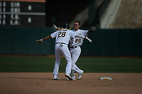 OAKLAND, CA - SEPTEMBER 18:  Mark Canha #20 of the Oakland Athletics celebrates with teammate Matt Olson #28 after driving in the winning run with a single in the bottom of the 11th inning to beat the Kansas City Royals 1-0 at the Oakland Coliseum on Wednesday, September 18, 2019 in Oakland, California. (Photo by Brad Mangin)