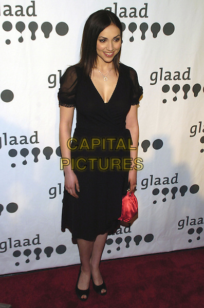 EDEN RIEGEL.Attending the GLAAD Media Awards (Gay and Lesbian Alliance Against Defamation) New York at the Mariott Marquis Hotel, New York City, NY, USA.March 26th, 2007.full length black dress red bag purse sheer sleeves.CAP/ADM/BL.©Bill Lyons/AdMedia/Capital Pictures *** Local Caption ***