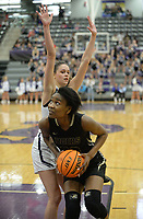 Bentonville's Maryam Dauda (right) drives to the lane Friday, Jan. 17, 2020, around Fayetteville's Sasha Goforth during the second half of play in Bulldog Arena in Fayetteville. Visit nwaonline.com/prepbball/ for a gallery from the games.<br /> (NWA Democrat-Gazette/Andy Shupe)
