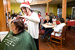 "TORRINGTON, CT-121917JS03---Torrington resident Dawn Veretto gets her hair cut and styled by Terri Hendrix, owner of Beauty and the Barber Tuesday at Jospeh's House, a Christ-Centered community ministry in Torrington. This is the second year Hendrix has volunteered her time and skills for the program ""Christmas Cuts"", which gives haircuts to those in need. Hendrix said she just loves to give back to the community. <br /> Jim Shannon Republican-American"