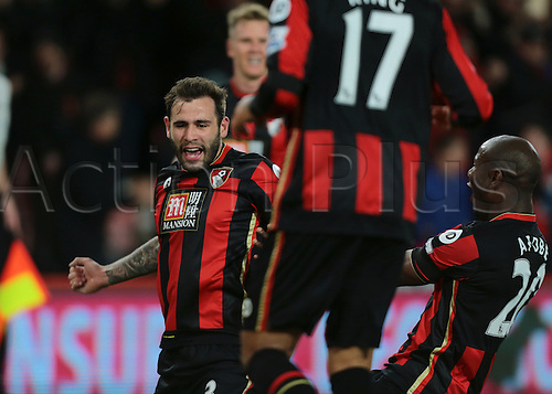 01.03.2016. Vitality Stadium, Bournemouth, England. Barclays Premier League. Bournemouth versus Southampton. Bournemouth Defender Steve Cook celebrates with Bournemouth Forward Benik Afobe, after scoring past Southampton Goalkeeper Fraser Forster, giving Bournemouth the lead, 1-0