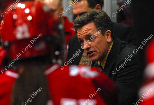 Coach Mark Johnson talks to players during a sweep of Minnesota, 1/5/07 and 1/6/07, at Ridder Arena in Minneapolis