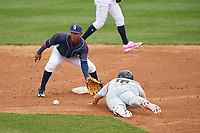 Wilmington Blue Rocks second baseman Jecksson Flores (4) waits for a throw as Austin Hays (18) slides in during the second game of a doubleheader against the Frederick Keys on May 14, 2017 at Daniel S. Frawley Stadium in Wilmington, Delaware.  Wilmington defeated Frederick 3-1.  (Mike Janes/Four Seam Images)