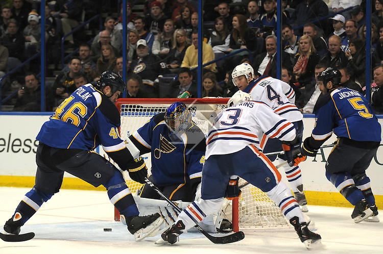 From left, St. Louis Blues defenseman Roman Polak (46), St. Louis Blues goalie Jake Allen (34), Edmonton Oilers center Ryan Nugent-Hopkins (93), Edmonton Oilers left wing Taylor Hall (4), and St. Louis Blues defenseman Barret Jackman (5) scurry around near the front of the Blues goal in second period action during a game between the Edmonton Oilers and the St. Louis Blues on Tuesday March 26, 2013 at the Scottrade Center in downtown St. Louis.