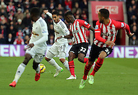 Pictured: Kyle Naughton of Swansea (2nd L) Sunday 01 February 2015<br />