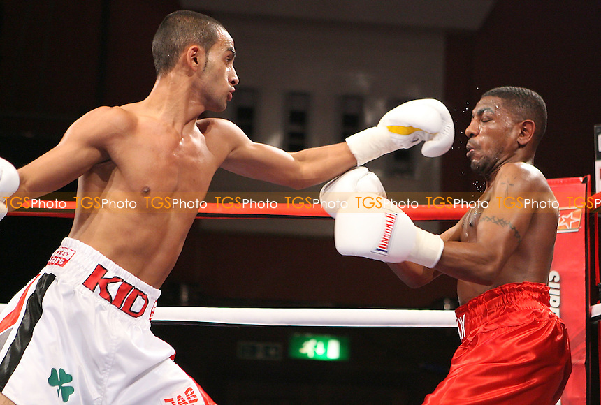 Kid Galahad (white shorts) defeats Delroy Spencer in a Bantamweight Boxing contest at Watford Colosseum, promoted by Hennessy Sports - 05/09/09 - MANDATORY CREDIT: Chris Royle/TGSPHOTO - Self billing applies where appropriate - Tel: 0845 094 6026