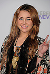 "{LOS ANGELES}, CA - {FEBRUARY} 08: Miley Cyrus  attends the ""Justin Bieber: Never Say Never"" Los Angeles Premiere at Nokia Theatre L.A. Live on February 8, 2011 in Los Angeles, California."