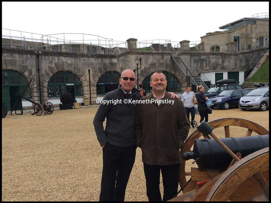 BNPS.co.uk (01202 558833)<br /> Pic: KennethPriestley/BNPS<br /> <br /> ***Please Use Full Byline***<br /> <br /> Ben Bennet and Paul Sandford. <br /> <br /> Friends and family gathered at the Nothe Fort, Weymouth, Dorset to see Derek's ashes being fired by cannon. <br /> <br /> A former army gunman's dying wish to go out with a bang became a reality when his ashes were fired from a 19th century cannon.<br /> <br /> With the full ceremony of an 1880s officer's funeral carried out by 20 re-enactors, Derek Chatting was given a very special send-off at a fort in Dorset - the first to be held there in more than 100 years.<br /> <br /> Derek served 24 years in the Royal Artillery, working his way up the ranks to Warrant Officer Class 2, and when he realised he was losing his battle with cancer he told his friends and family about the unusual alternative he wanted to having his ashes scattered.<br /> <br /> He died in July, aged 59, after battling brain and lung tumours for nearly four years and his former army pals Kenneth Priestley, Peter Rigby and Nick Mercer started working out how to make his final request happen.