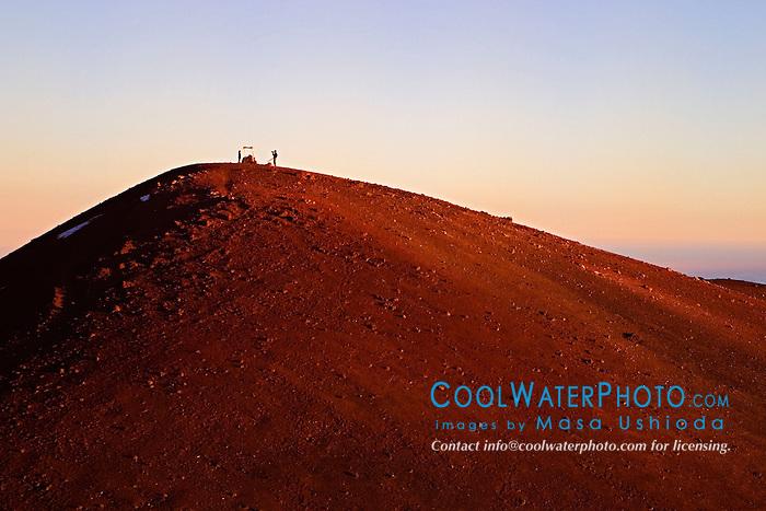 Hikers, Lele Ho`okau or Hawaiian altar at Mauna Kea Summit, 13,796 feet or 4,205 meters above sea level, Big Island, Hawaii