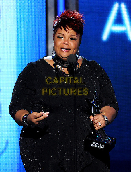 LOS ANGELES, CA - JUNE 29 : Tamela Mann accepts the Best New Gospel Artist award onstage at the BET Awards '14 at Nokia Theatre L.A. Live on June 29, 2014 in Los Angeles, California. <br /> CAP/MPI/PGMIC<br /> &copy;PGMIC/MPI/Capital Pictures