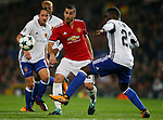 Henrikh Mkhitaryan of Manchester United (C) is tackled by Luca Zuffi of Basel (L) and Eder Alvarez Balanta of Basel (R) during the Champions League Group A match at the Old Trafford Stadium, Manchester. Picture date: September 12th 2017. Picture credit should read: Andrew Yates/Sportimage