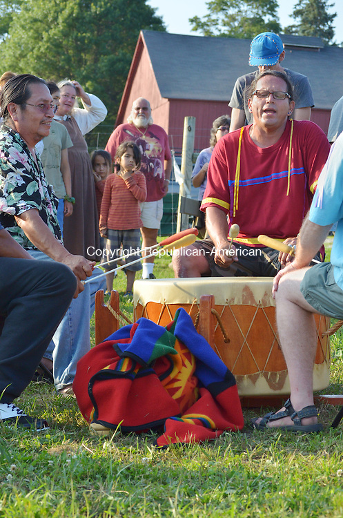 GOSHEN, CT- 16 July 2013 071613AP07- Steve Stonearrow, an Elder from a South Darkota Tribe, sings and plays the drum to celebrate the birthday of the sacred bison.  Alexandra Pape. Republican-American