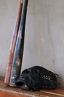 Baseball bats and a glove sit in the Winston-Salem Dash dugout prior to the game against the Lynchburg Hillcats at BB&T Ballpark on August 13, 2014 in Winston-Salem, North Carolina.  The Hillcats defeated the Dash 4-3.   (Brian Westerholt/Four Seam Images)