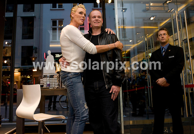 **ALL ROUND PICTURES FROM SOLARPIX.COM**.**SYNDICATION RIGHTS FOR UK AND SPAIN ONLY**.Brigitte Nielsen, Gitte,  signing her memoirs at the Illum department store in Copenhagen, Denmark. Her explosive memoirs  contains the tales of a one night stand with Sean Penn - with Madonna banging on the door to come in - as well as exposing her violent marriage to racer Raul Meyer..JOB REF: 10206         CPR        DATE:29.10.09.**MUST CREDIT SOLARPIX.COM OR DOUBLE FEE WILL BE CHARGED**.**MUST NOTIFY SOLARPIX OF ONLINE USAGE**.**CALL US ON: +34 952 811 768 or LOW RATE FROM UK 0844 617 7637**