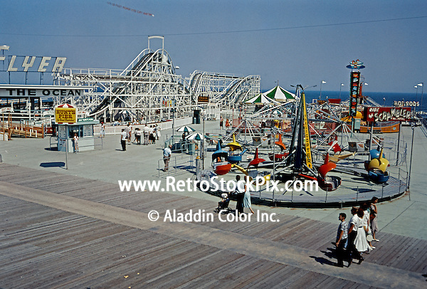 Hunts Pier in Wildwood, NJ in the 1950's. Flyer Roller Coaster, Helicopter Ride, Scrambler, Hot Rods. 1950's