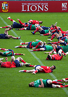 Players stretch during the 2017 DHL Lions Series rugby union  British & Irish Lions captain's run at QBE Stadium in Albany New Zealand on Tuesday, 6 June 2017. Photo: Dave Lintott / lintottphoto.co.nz