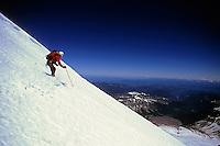 Rob Hahn wolfing down the 2,800 meters of skiing vertical drop down Emmons Glacier, Mt Rainier, Washington, USA