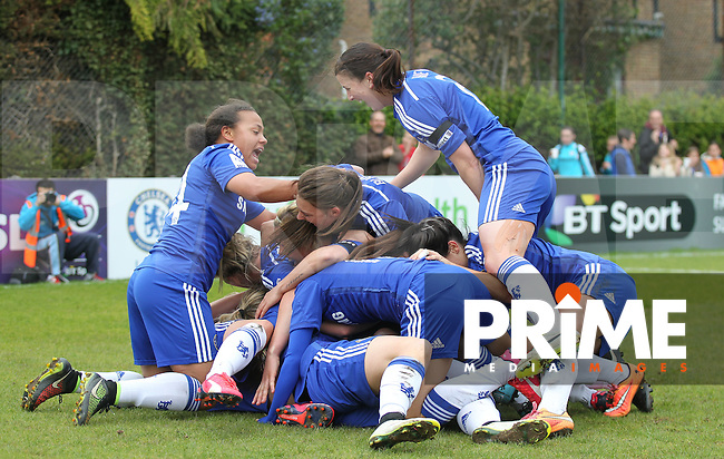 Celebrations as Eniola Aluko of Chelsea Ladies hits the winning goal during the Women FAWSL match between Chelsea Ladies and Liverpool Ladies at Wheatsheaf Park, Staines, England on 19 April 2015. Photo by Andy Rowland.