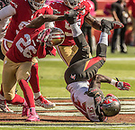San Francisco 49ers cornerback Tramaine Brock (26) tackles Tampa Bay Buccaneers running back Antone Smith (36) on Sunday, October 23, 2016, at Levis Stadium in Santa Clara, California. The Buccaneers defeated the 49ers 34-17.
