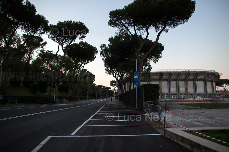Outdoor activities allowed in proximity of home.<br /> <br /> Rome, 16/03/20. Rome's Olympic Village district under the Italian Government lockdown for the Outbreak of the Coronavirus SARS-CoV-2 - COVID-19. On 22 March, the Italian PM Giuseppe Conte signed a new Decree Law which suspends non-essential industry productions and contains the list of allowed working activities, which includes Pharmaceutical & food Industry, oil & gas extraction, clothes & fabric, tobacco, transports, postal & banking services (timetables & number of agencies reduced), delivery, security, hotels, communication & info services, architecture & engineer, IT manufacturers & shops, call centers, domestic personnel (1.).<br /> Updates: Italy: 22.03.20, 6:00PM: 46.638 positive cases; 7.024 recovered; 5.476 died.<br /> <br /> The Rome's Olympic Village (1957-1960) was designed by: V. Cafiero, A. Libera, A. Luccichenti, V. Monaco, L. Moretti. «Built to host the approximately 8,000 athletes involved in the 1960 Olympic Games, Rome's Olympic Village is a residential complex located between Via Flaminia, the slopes of Villa Glori and Monti Parioli. It was converted into public housing [6500 inhabitants, ndr] at the end of the sporting event. The intervention is an example of organic settlement, characterized by a strong formal homogeneity, consistent with the Modern Movement's principles of urbanism. The different architectural structures are made uniform by the use of some common elements: the pilotis, ribbon windows, concrete stringcourses, and yellow brick curtain covering. At the center of the neighborhood, the Corso Francia viaduct - a road bridge about one kilometer long - was built by P.L. Nervi[…]» (2.).<br /> <br /> Info COVID-19 in Italy: http://bit.do/fzRVu (ITA) - http://bit.do/fzRV5 (ENG)<br /> 1. March 22nd Decree Law http://bit.do/fFwJn (ITA)<br /> 2. (Atlantearchitetture.beniculturali.it MiBACT, ITA - ENG) http://bit.do/fFw3H<br /> 12.03.20 Rome's Lockdown for the Outbreak of the Cor