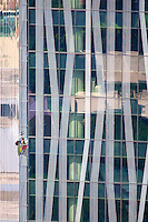 High rise window cleaner and Skyline of Makati High-Rise Buildings and financial district, Manila Philippines