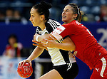 BELGRADE, SERBIA - DECEMBER 15:  Liudmila Postnova of Russia (L)  is challenged by Louise Burgaard (R) of Denmark during the Women's European Handball Championship 2012 fifth place match between Denmark and Russia at Arena Hall on December 15, 2012 in Belgrade, Serbia. (Photo by Srdjan Stevanovic/Getty Images)