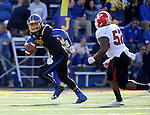 BROOKINGS, SD - OCTOBER 22:  Taryn Christion #3 from South Dakota State University scrambles away from Savon Smith #52 from Youngstown State in the first half of their game Saturday afternoon at Dana J. Dykhouse Stadium in Brookings. (Photo by Dave Eggen/Inertia)