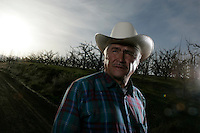 Story on Evaristo Silva and his complicated views on immigration based on his life experiences. Silva snuck into the country illegally, going without water for days in desert. He became a farm worker, brought his family to the US, and eventually became a citizen and bought a small apple orchard in Washington. But the orchard is struggling financially and Silva now supports bringing in guest workers from Mexico to tend the fields.