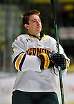 22 November 2011: University of Vermont Catamount forward Kyle Reynolds, a Freshman from Sylvan Lake, Alberta, awaits game introductions prior to facing the University of Massachusetts Minutemen at Gutterson Fieldhouse in Burlington, Vermont. The Catamounts defeated the Minutemen 2-1 in their annual pre-Thanksgiving meeting of the Hockey East season. Mandatory Credit: Ed Wolfstein Photo