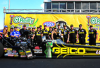 Apr. 29, 2012; Baytown, TX, USA: NHRA top fuel dragster driver Morgan Lucas celebrates with fiance Katie Pallone and crew after winning the Spring Nationals at Royal Purple Raceway. Mandatory Credit: Mark J. Rebilas-