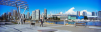 City of Vancouver Skyline, BC Place Stadium (New Retractable Roof completed in 2011), Edgewater Casino, and Rogers Arena viewed from the Seawall at The Village on False Creek (aka Olympic Village), Vancouver, BC, British Columbia, Canada - Panoramic View