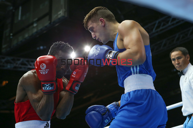 Glasgow 2014 Commonwealth Games<br /> Men's Light Welter (64kg)<br /> Zack Davies, Wales (Blue) v Waheed Shogbamu, Nigeria (Red)<br /> 27.07.14<br /> ©Steve Pope-SPORTINGWALES
