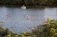 The latest exercise trend, Yoga paddle boarding, happens in middle of Lady Bird Lake