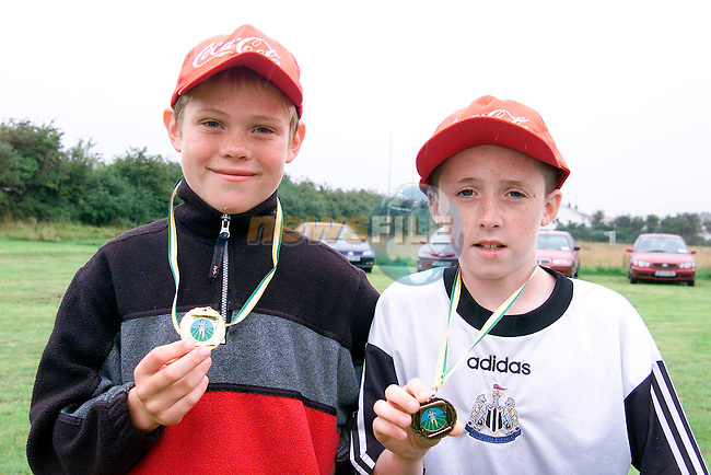 David McEntaggart who won gold in the boys under 10 100 metre and Ronan McEntaggart who won bronze at the Boyne AC Sports Day which was sponsered by Drogheda Concentrates...Picture Paul Mohan Newsfile
