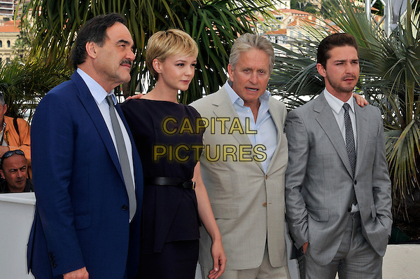 OLIVER STONE, CAREY MULLIGAN, MICHAEL DOUGLAS & SHIA LaBEOUF.The 'Wall Street: Money Never Sleeps' Photo Call held at the Palais des Festivals during the 63rd Annual International Cannes Film Festival, Cannes, France. .May 14th, 2010.half length suit jacket dress navy belt sleeveless grey gray LaBeouf La Boeuf blue moustache mustache facial hair.CAP/PL.©Phil Loftus/Capital Pictures.