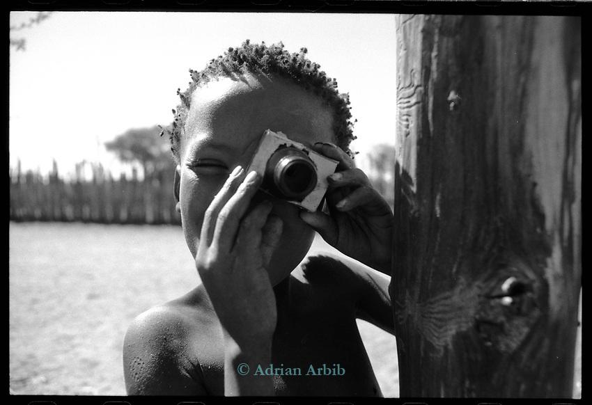 San boy in Tchumkwe, Bushmanland. Namibia