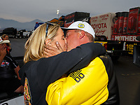 Nov 12, 2017; Pomona, CA, USA; NHRA pro stock driver Bo Butner kisses girlfriend Randi Lynn Shipp as they celebrate after clinching the 2017 championship during the Auto Club Finals at Auto Club Raceway at Pomona. Mandatory Credit: Mark J. Rebilas-USA TODAY Sports