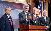 "United States Senator Bill Cassidy (Republican of Louisiana), center, one of several key Republican Senators, makes a statement as he announces he will not support the ""skinny repeal"" of the Affordable Care Act (ACA) unless he has assurances from US House leaders that the bill will never become law.  Instead they demand negotiations or they will kill the bill, in the US Capitol in Washington, DC on Thursday, July 27, 2017.  From left to right: US Senator Lindsey Graham (Republican of South Carolina), Senator Cassidy, US Ron Johnson (Republican of Wisconsin), and US Senator John McCain (Republican of Arizona).<br /> Credit: Ron Sachs / CNP"