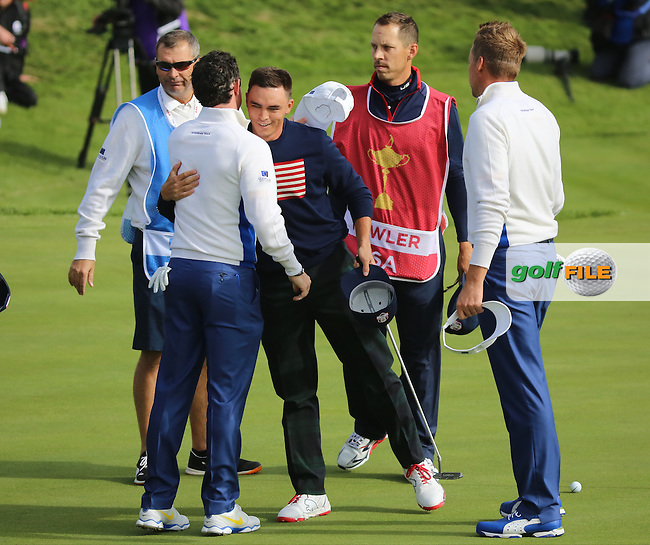 Rickie Fowler (USA) embraces Rory McIlroy (EUR) during the Saturday morning Fourballs of the 2014 Ryder Cup at Gleneagles. The 40th Ryder Cup is being played over the PGA Centenary Course at The Gleneagles Hotel, Perthshire from 26th to 28th September 2014.: Picture Kenneth E.Dennis, www.golffile.ie: \27/09/2014\