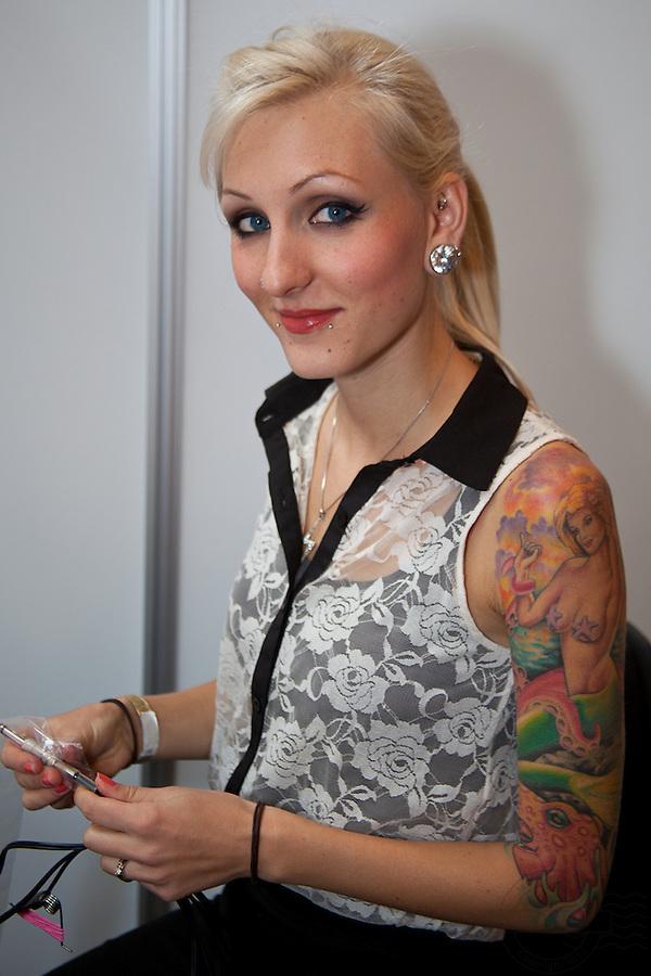 Copenhagen Inkfestival 2012. Tattoo artist from Miami Tattoo Co with colorfull mermaid on shoulder. www.miamitattooco.com
