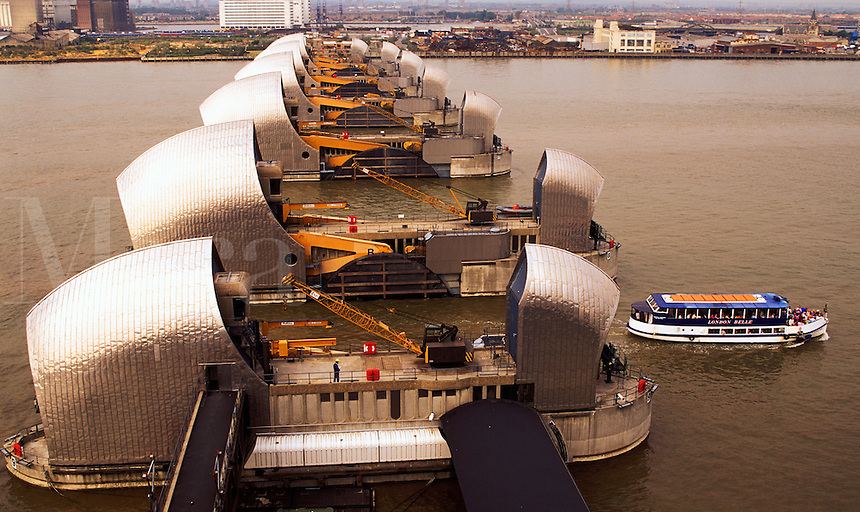 England. London.  Thames Flood Barrier with tourist boat.