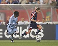 New England Revolution midfielder Steve Ralston (14) dribbles as Colorado Rapids defender Ugo Ihemelu (4) closes. The New England Revolution tied the Colorado Rapids, 1-1, at Gillette Stadium on May 16, 2009.