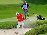 Potomac, MD - June 29, 2017: Rickie Fowler plays a shot from the bunker on the 15th hole during Round 1 of professional play at the Quicken Loans National Tournament at TPC Potomac at Avenel Farm in Potomac, MD, June 29, 2017, as his caddie Joe Skovron looks on.  (Photo by Don Baxter/Media Images International)